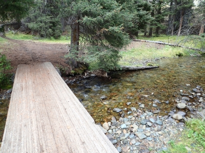 The bridge across Bear Valley Creek near the Upper Trailhead.  Other big water crossings also have bridges going up to the lake. Photo by David Lingle.