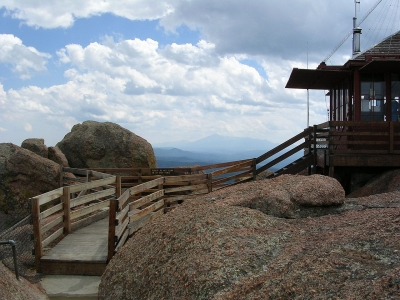 Picture of lookout tower at Devil's Head, Colorado. Pike's Peak is visible in the background. Photo by Glennfcowan/wiki.