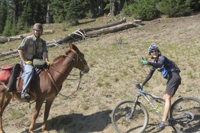 An equestrian and a hiker do a meet and greet on the Metolius-Windigo Trail. Photo by Kim McCarrel.