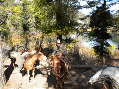 Back country guide and pack string near Palisades Lower Lake. Photo by USDA Forest Service Staff.