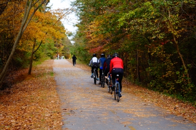 Bike racing and running along the trail. Photo by Sarina Lewis.