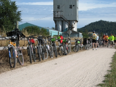 Bicycles lined up along the fence at Pringle. One of the Trailheads along the Mickelson Trail. Photo by Brooke Smith.