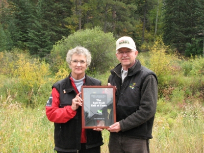 Harley Noem receives Certificate of Introduction to Rails-to-Trails Hall of Fame from Linda Mickelson Graham. Photo by Brooke Smith.