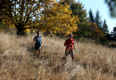 Runners take advantage of a sunny day on the Ridgeline Trail. Photo by Chris Pietsch.