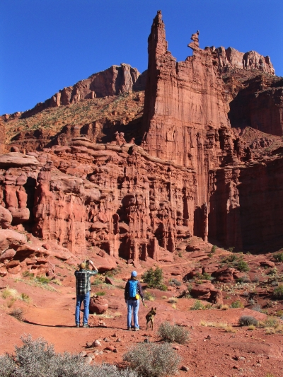 Hikers and leashed dog on the Fisher Towers trail. Photo by Valerie A. Russo.