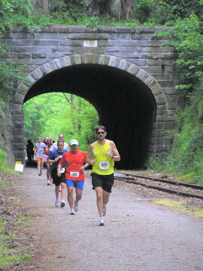 Runners in Bob Potts Marathon coming out of the tunnel. Photo by Carl R. Knoch.
