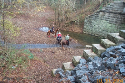 Riders near bridge abutments. Photo by Beth McCreless.