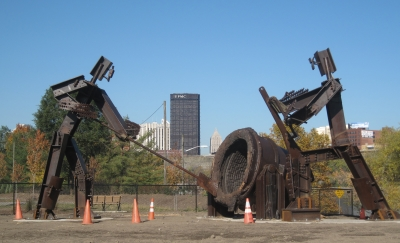 The Workers. Two 18-foot metal steelworkers stand beside the trail. Photo by Mary Shaw.