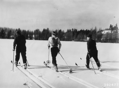 Vintage 1940 ski party crossing  a small frozen lake on one of the ski trails at Shingobee Winter Playground. Photo by Dept of Agriculture/wiki.