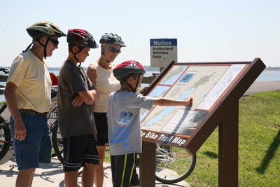 Bicyclist stop to view the Carlyle Lake Bike Trail