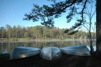 Boats on the shore of Blue Heron Lake