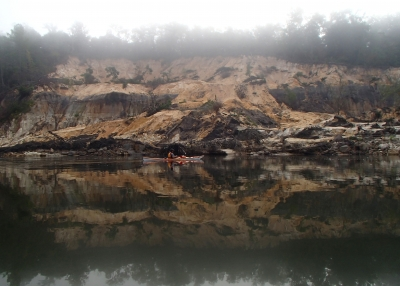 Kayaker by Alum Bluff on a foggy morning. Photo by Doug Alderson.