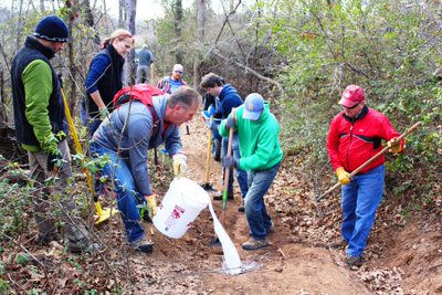 Volunteers during cleanup event working on a trail