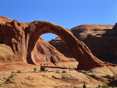 Hikers beneath Corona Arch. Photo by Valerie A. Russo.