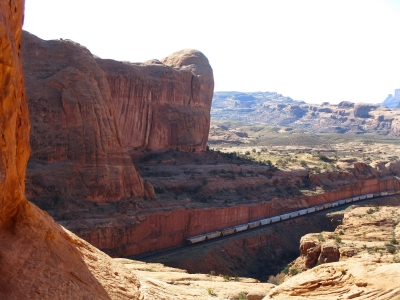 A train carrying potash can be seen from the base of Corona Arch. Photo by Valerie A. Russo.