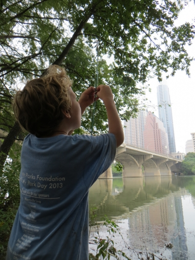 A young angler along the Ann and Roy Butler Hike and Bike Trail on Ladybird Lake in downtown Austin, Texas. Photo by Chris Sheffield.
