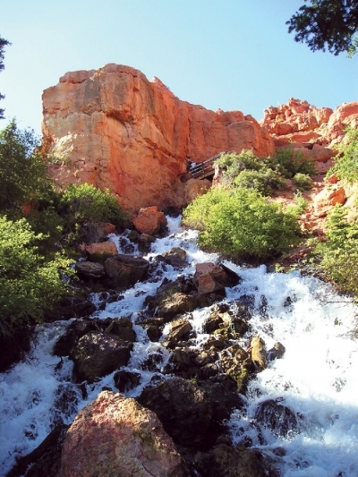 Cascade Falls just below the cave opening, forming the headwaters of the North Fork of the Virgin River. Photo by Lance Weaver, Utah Geo. Survey.