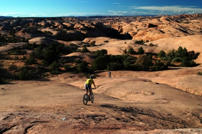 Mountain Bikers on slickrock bike trail in Moab, UT. Photo by Wikicommons.