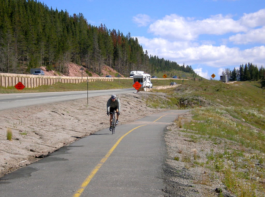 photo: Cyclist on the paved, dedicated bike route. Photo by Ericshawwhite.