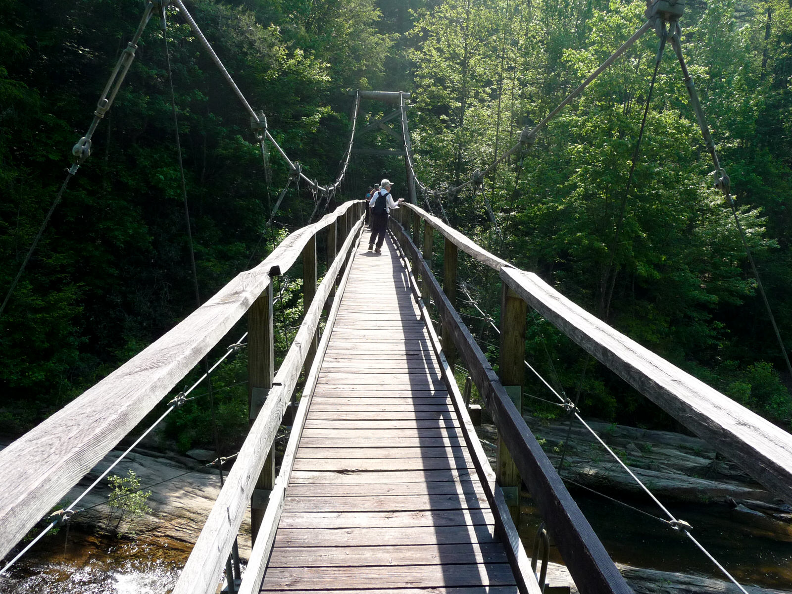 photo: Crossing the Toxaway River suspension bridge. Photo by Debbie Biddle.