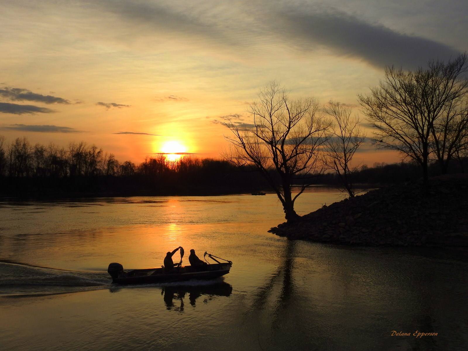 photo: White River Sunset at the Jacksonport State Park near Tunstall Riverwalk Trail. Photo by Delana Epperson.