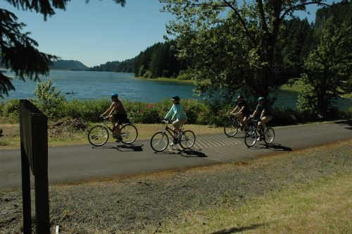 photo: Bicyclists enjoying a ride around Dorena Reservoir along the Row River Trail