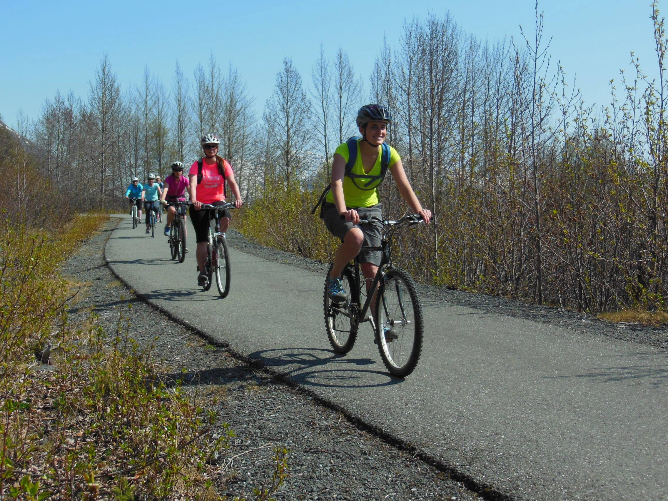 photo: Bicyclists enoying spring sunshine on the Bird-to-Gird Trail near Anchorage. Photo by Susan Sommer.