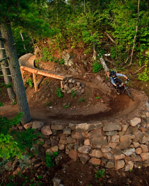 photo: A rider descends the final turns of the Flow Trail