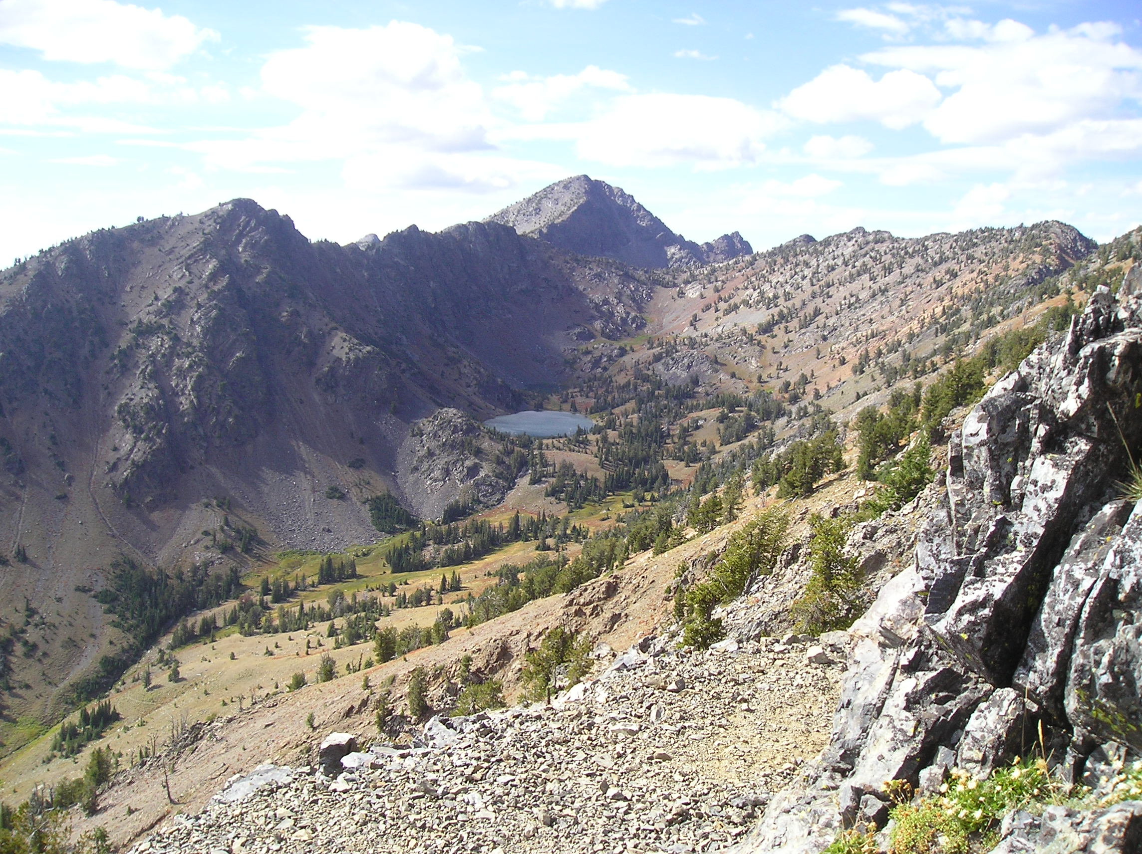photo: HIgh mountain Twin Lakes in distance along the rugged Elkhorn Crest Trail. Photo by USDA Forest Service.