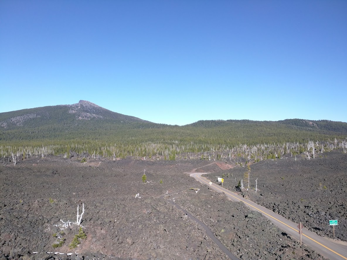 photo: The Lava River Trail winds through a massive lava flow and features many interpretive signs. Photo by Chris Chandler.